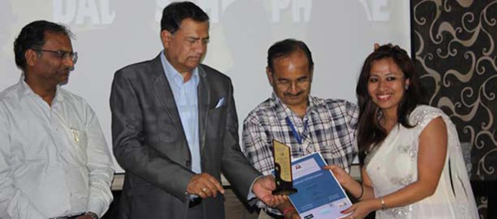 Padmini receiving the award