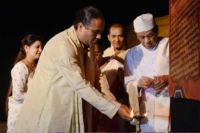 Janardan Devagoswami and Bhadrakrishna Devagoswami lighting the traditional lamp during 'Nrityaprabha'