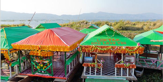 boating on loktake lake, manipur